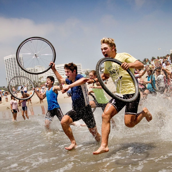 Teens complete their coast to coast adventure bike trip by running into the Pacific Ocean