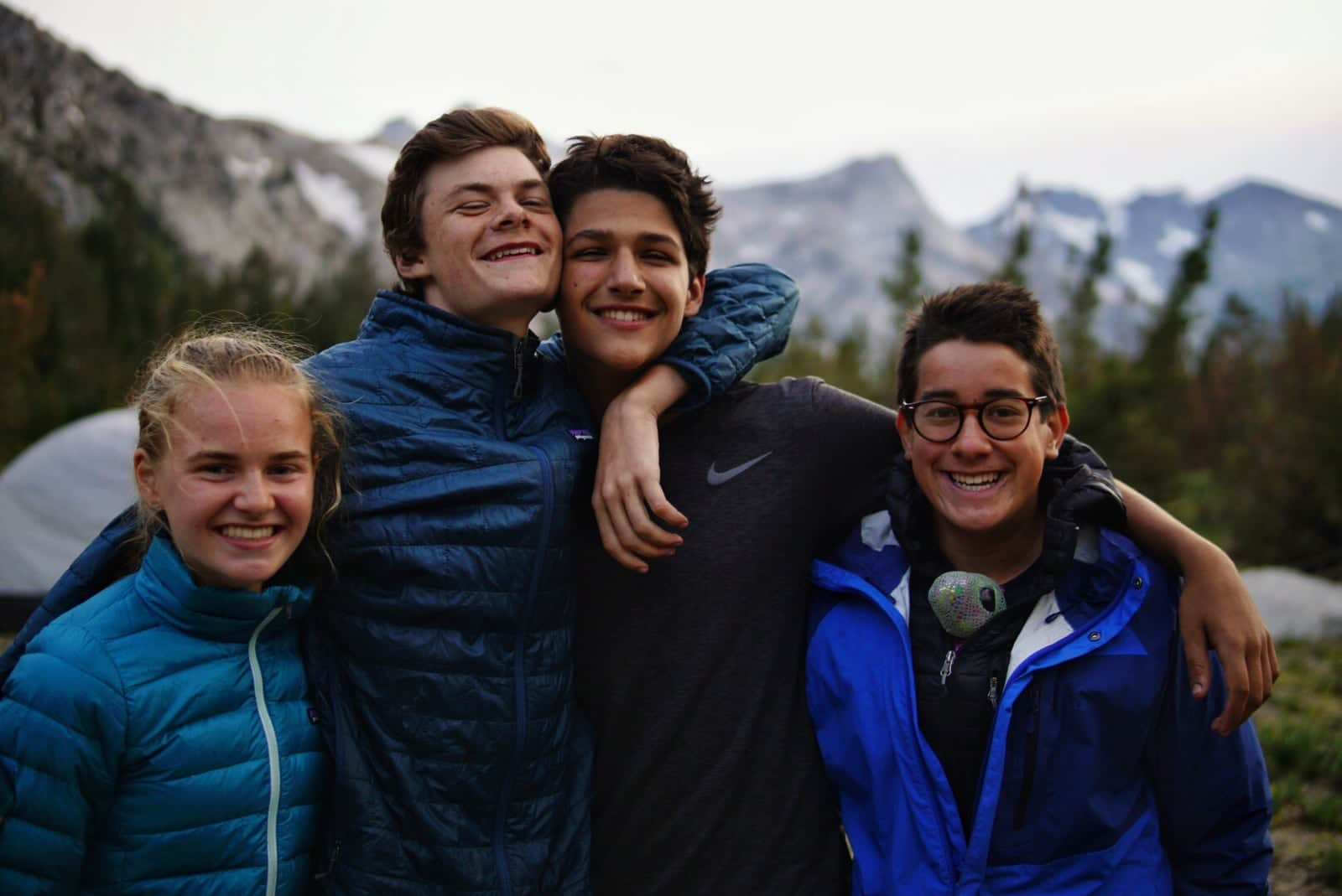 Campers become friends while hiking in the high sierras this summer on an adventure program