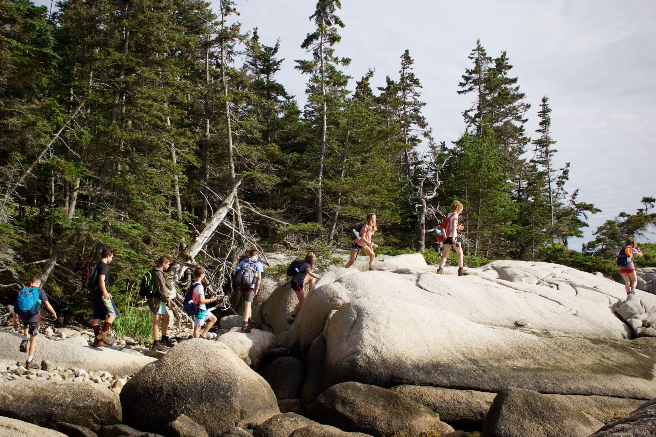 A group of camper traversing the rocky Maine Coast this summer during their adventure program