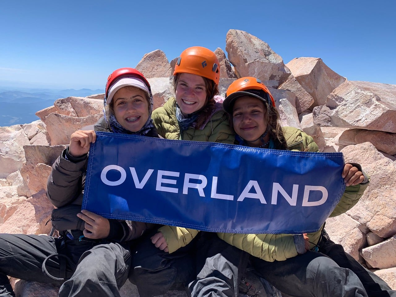 Three campers representing overland summer adventure programs