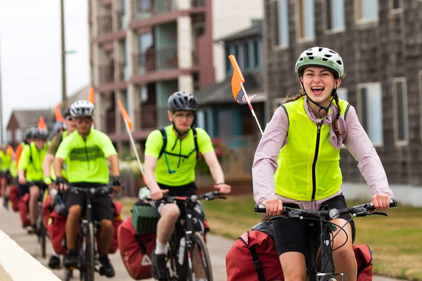 Single file for safety on a teen summer biking trip
