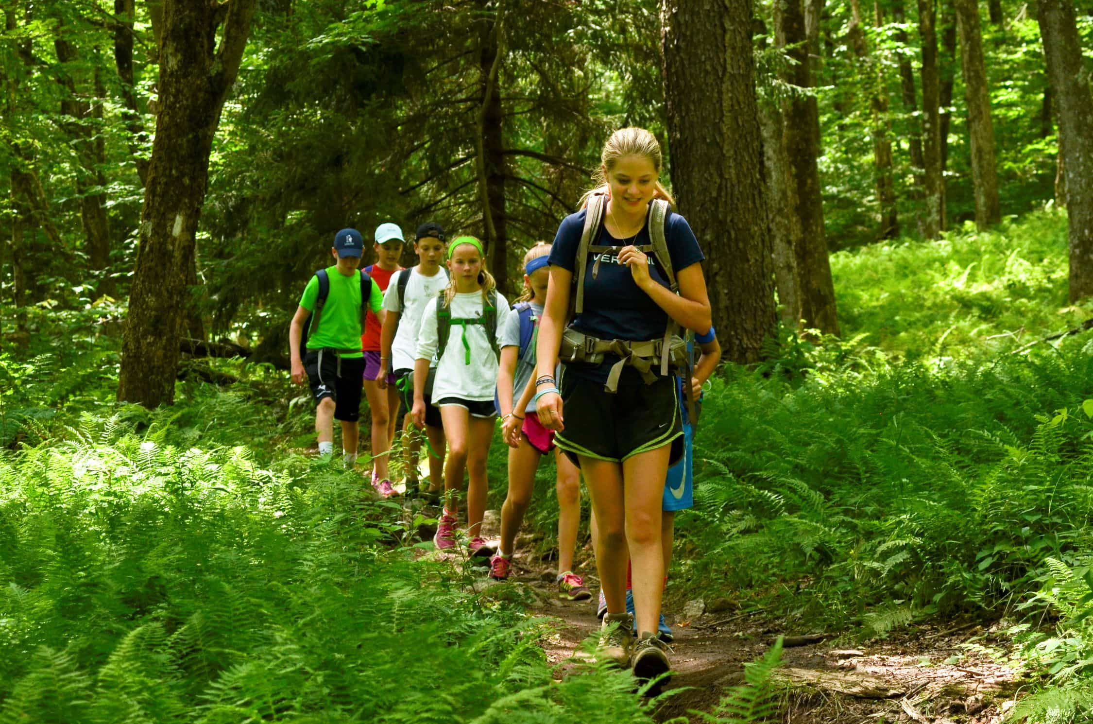 A group hiking on a teen adventure program in New England