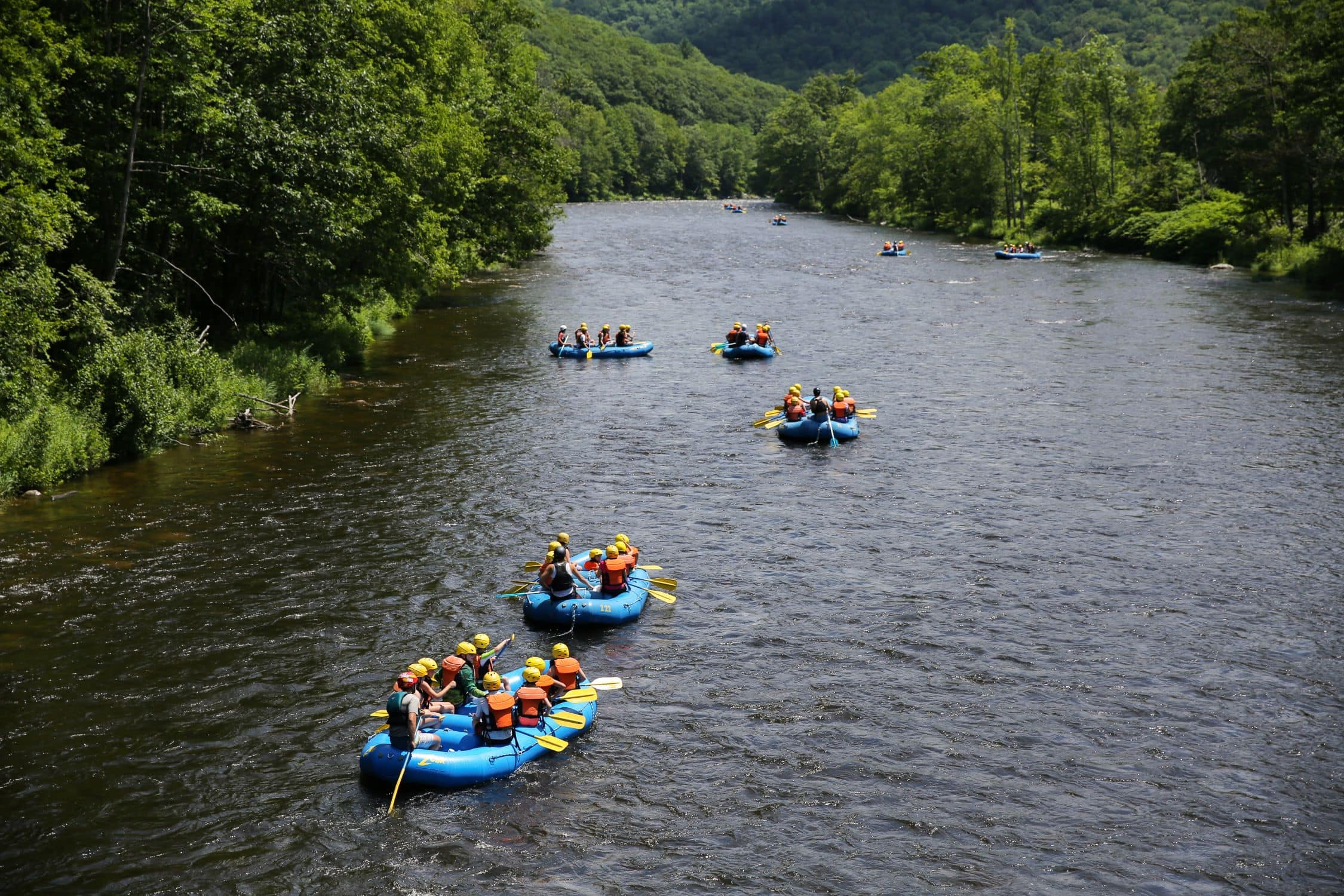 Rafting down a river during a teen adventure program in New England