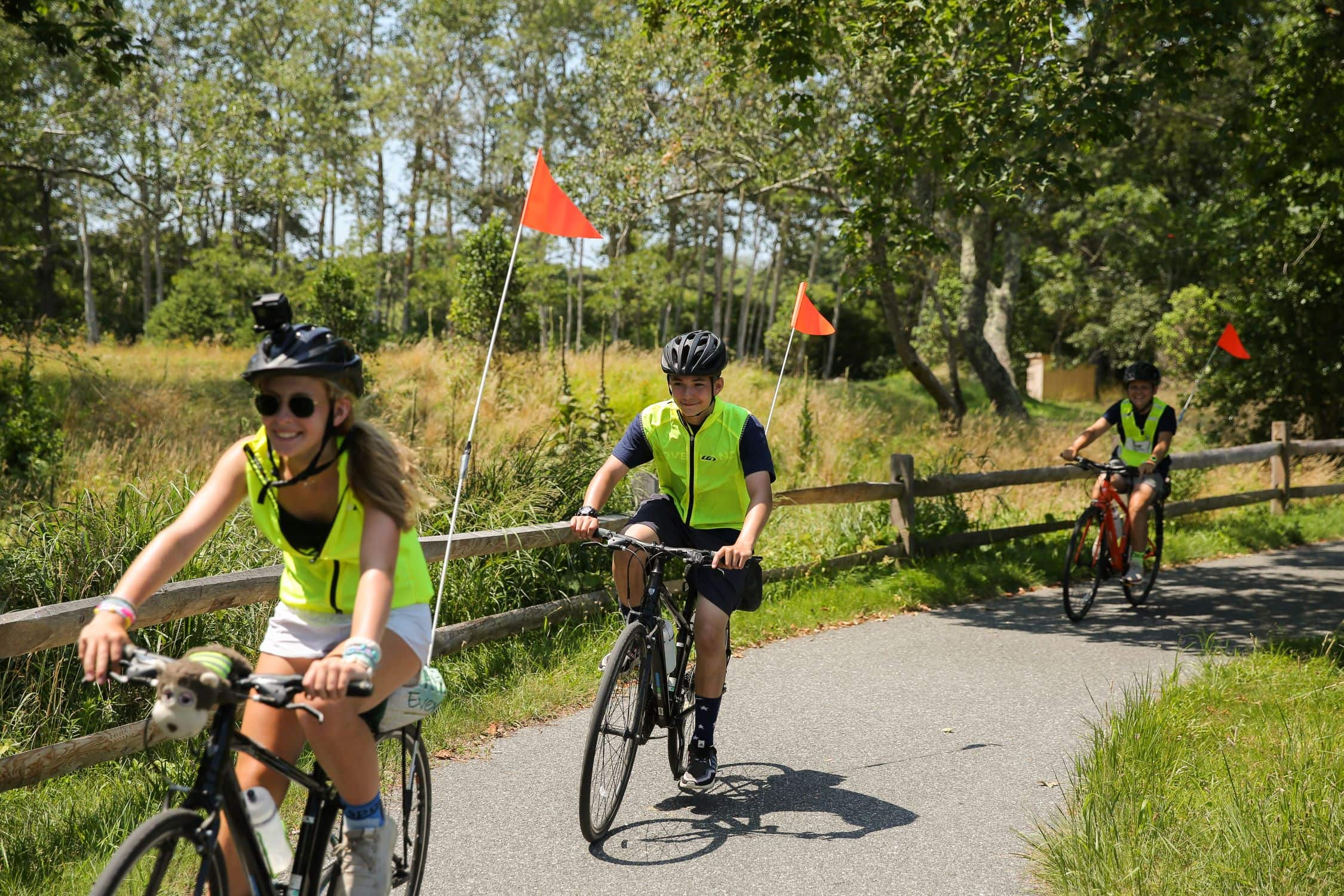 Three campers biking down the road on a trip this summer on Cape Cod