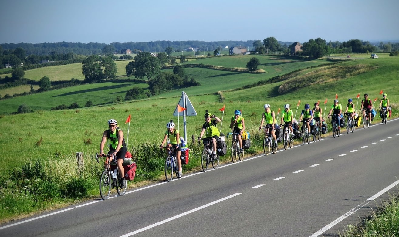 A bucolic view behind a group on a teen summer biking tour of europe