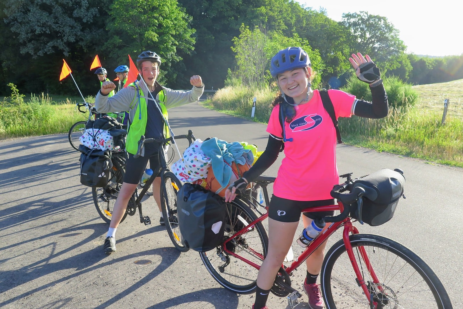 Campers stop to pose and rest their legs on this teen summer biking trip through europe