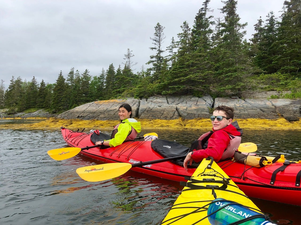 Tandem kayaking with friends in Nova Scotia on a teen adventure program