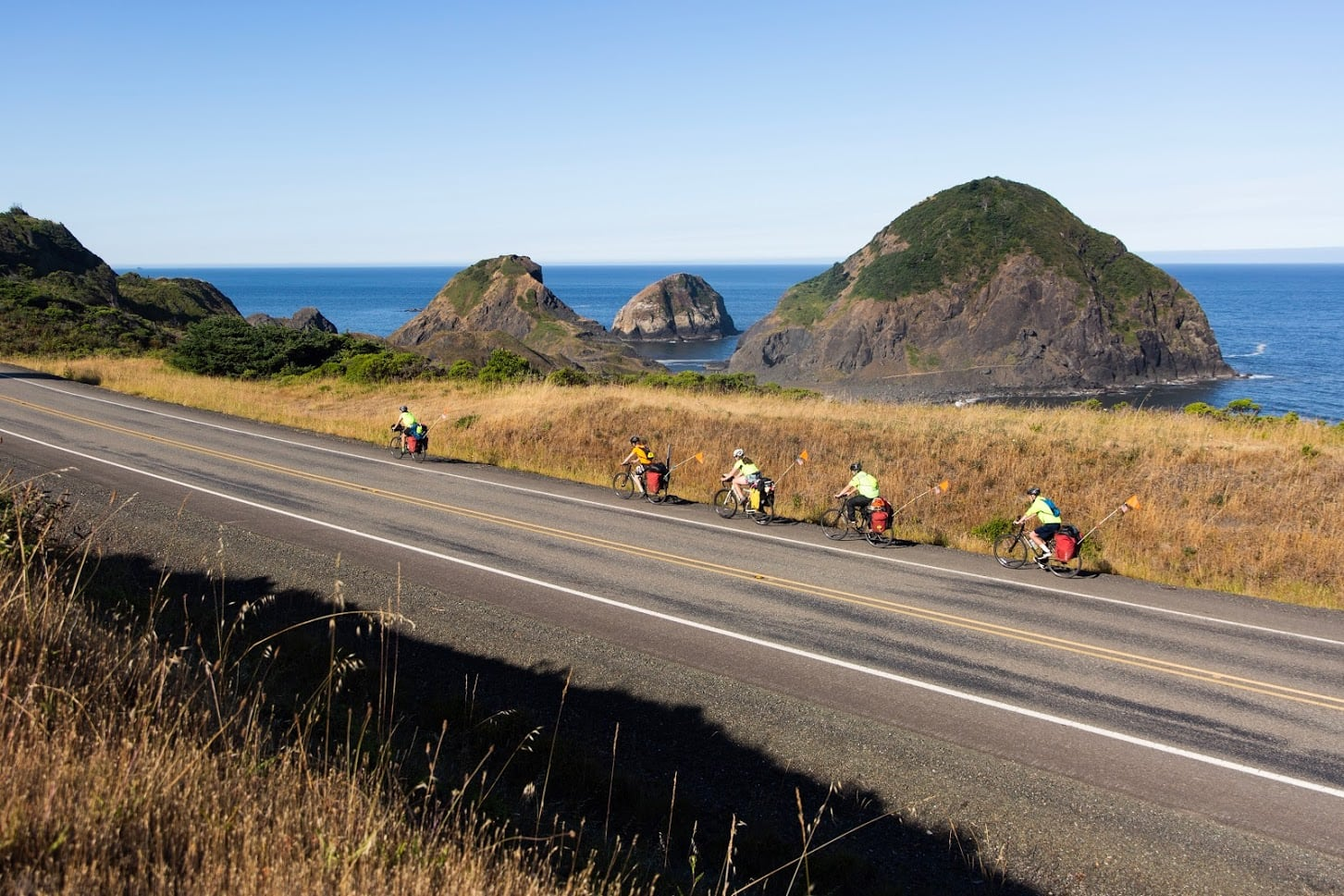A stunning view of the Pacific coast in the background of a teen summer biking trip