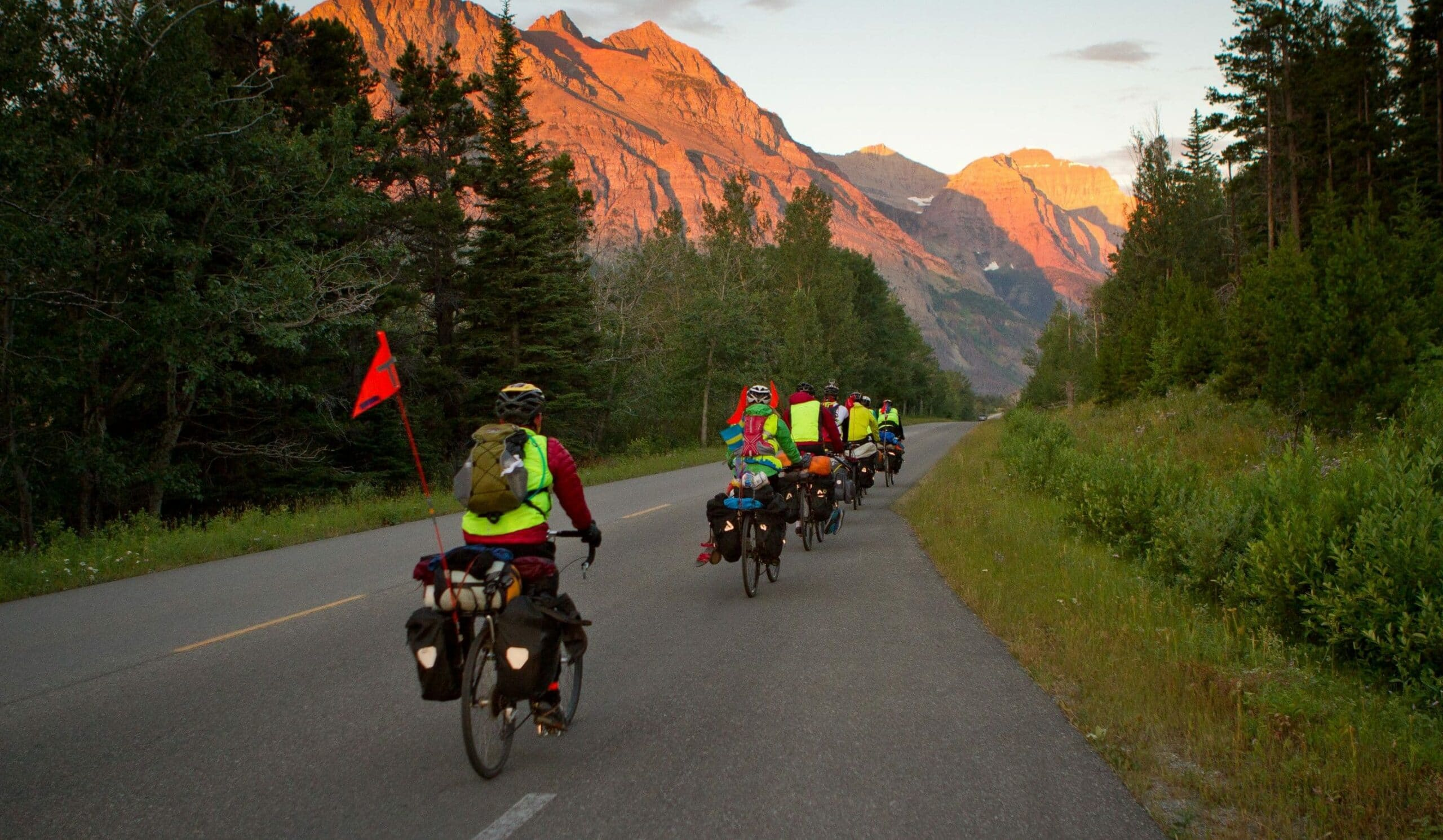 Sunrise on the mountains cycling on a teen summer biking trip in the Canadian Rockies