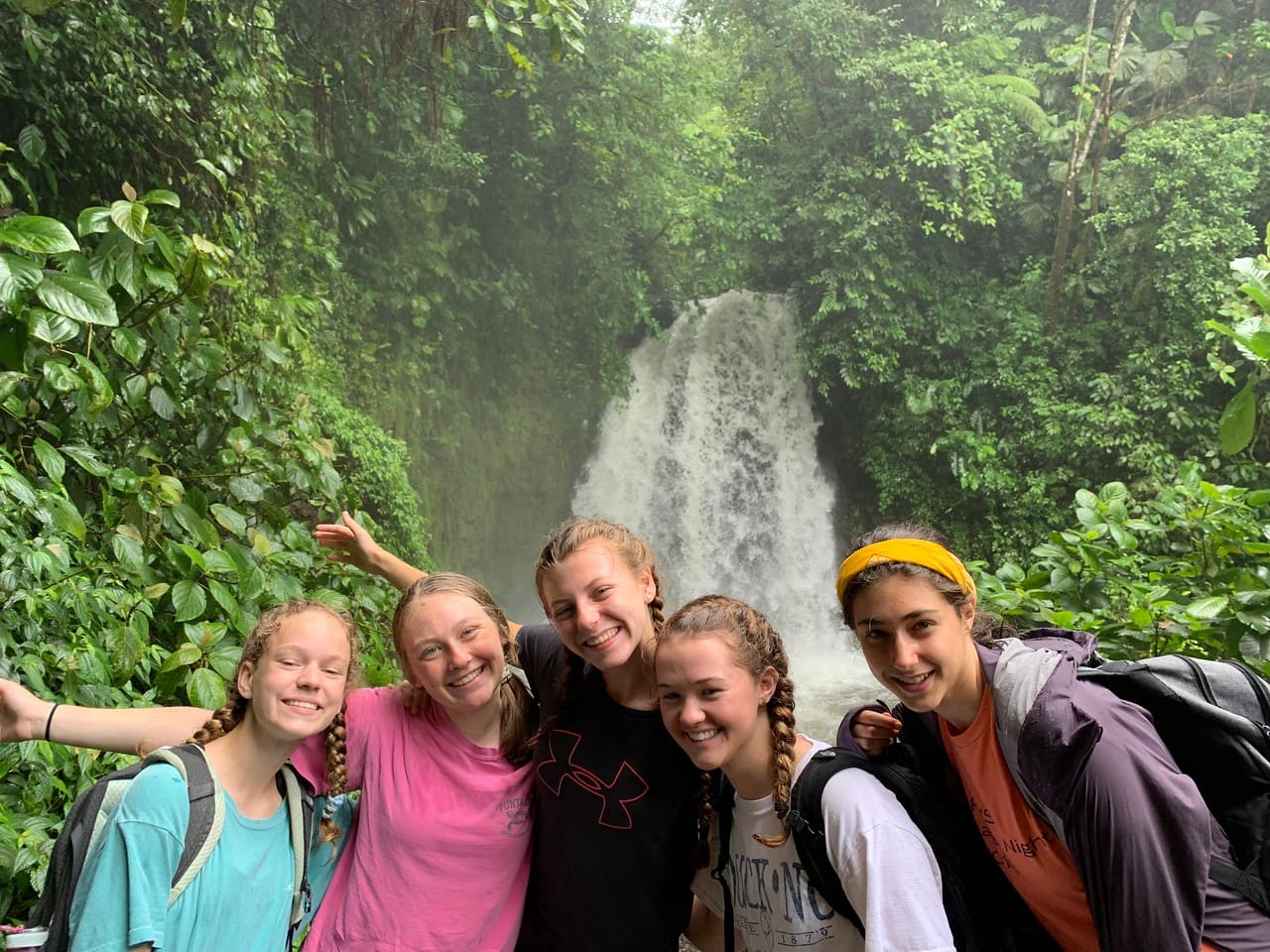 Teens gather for a group photo on a summer hike in Costa Rica
