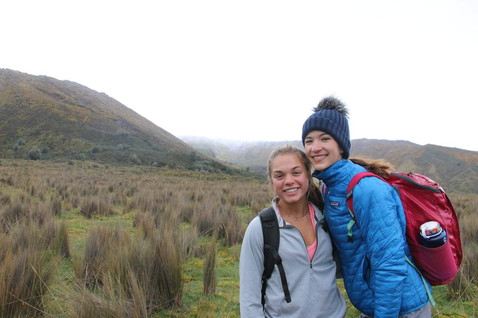 Two teenagers take a break from hiking to snap a picture on a field studies program in Ecuador this Summer