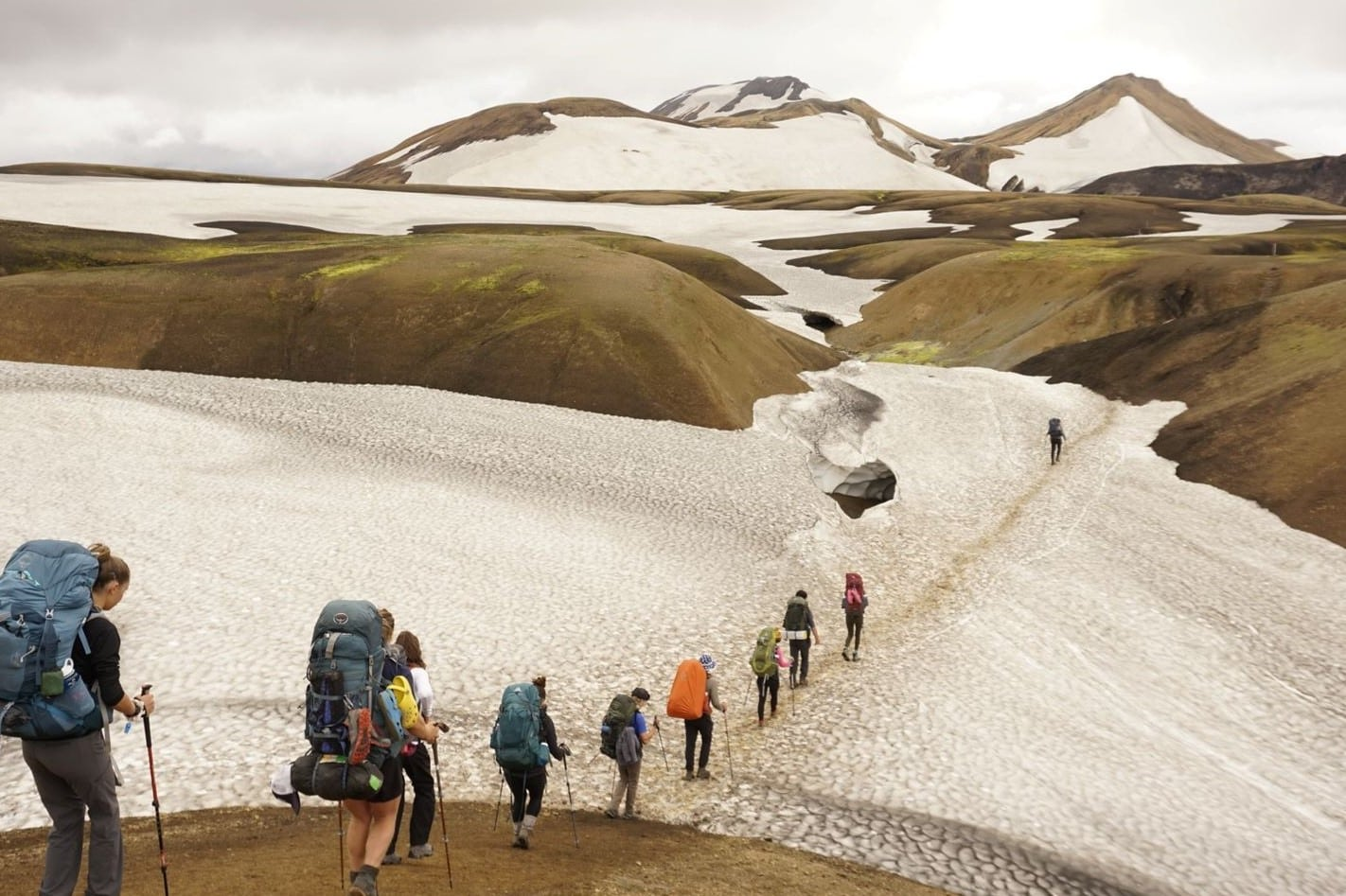 Campers hike single file while traversing the wilderness of Iceland this Summer