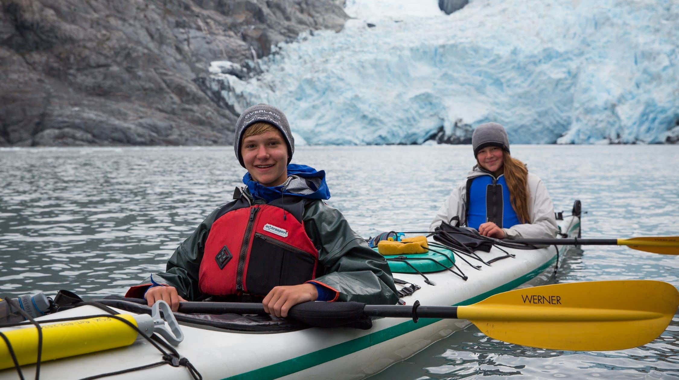 Tandem kayaks in front of Alaskan glaciers on this summer adventure trip