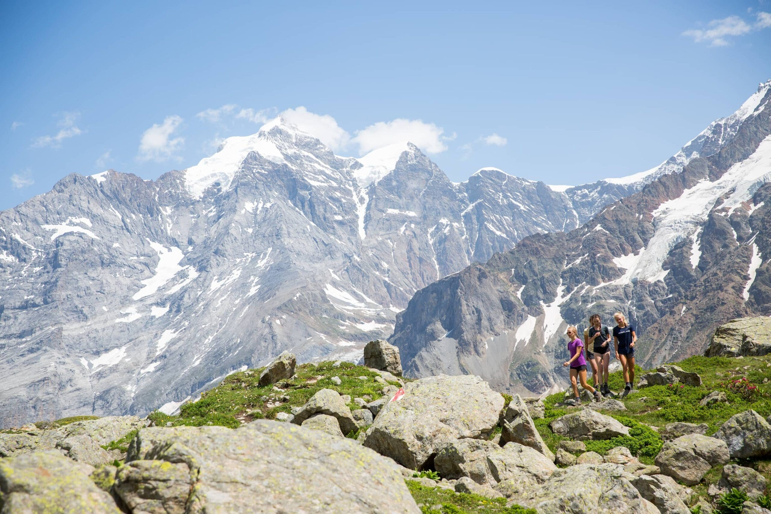 Group of teenager pose for a photo while on a hiking trip in the Swiss Alps this Summer