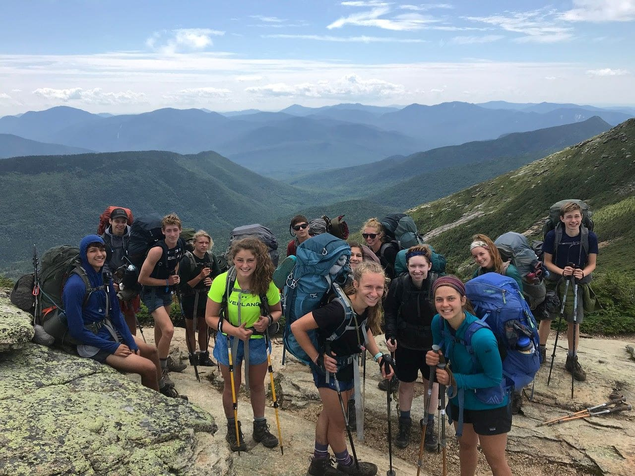 A group of campers stops to rest their legs this summer while on a hiking trip in the beautiful Appalachians