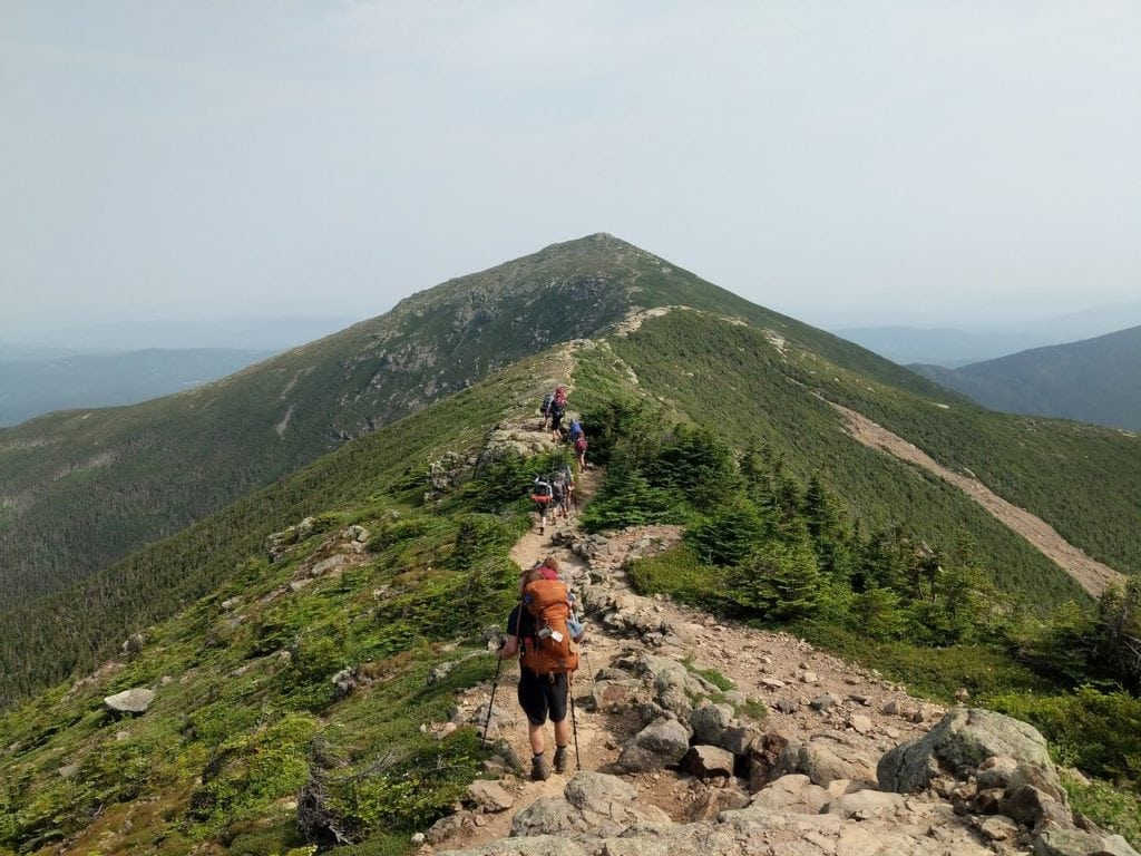 A group of campers ridge on the Appalachian trail while on an overland hiking trip this summer