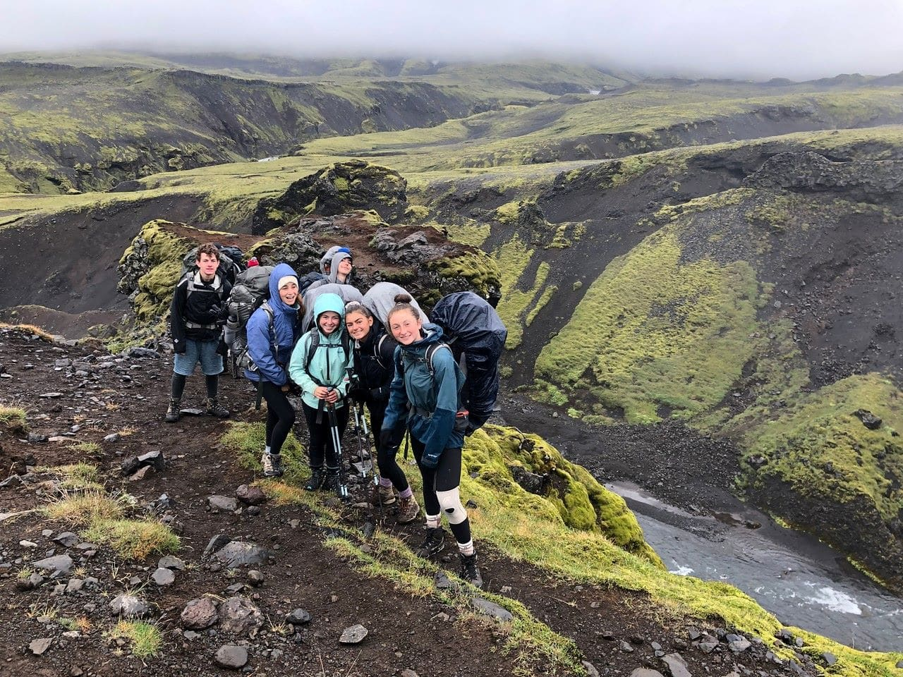Rain can't keep our campers from posing for a group photo when on a hiking trip in Iceland this summer
