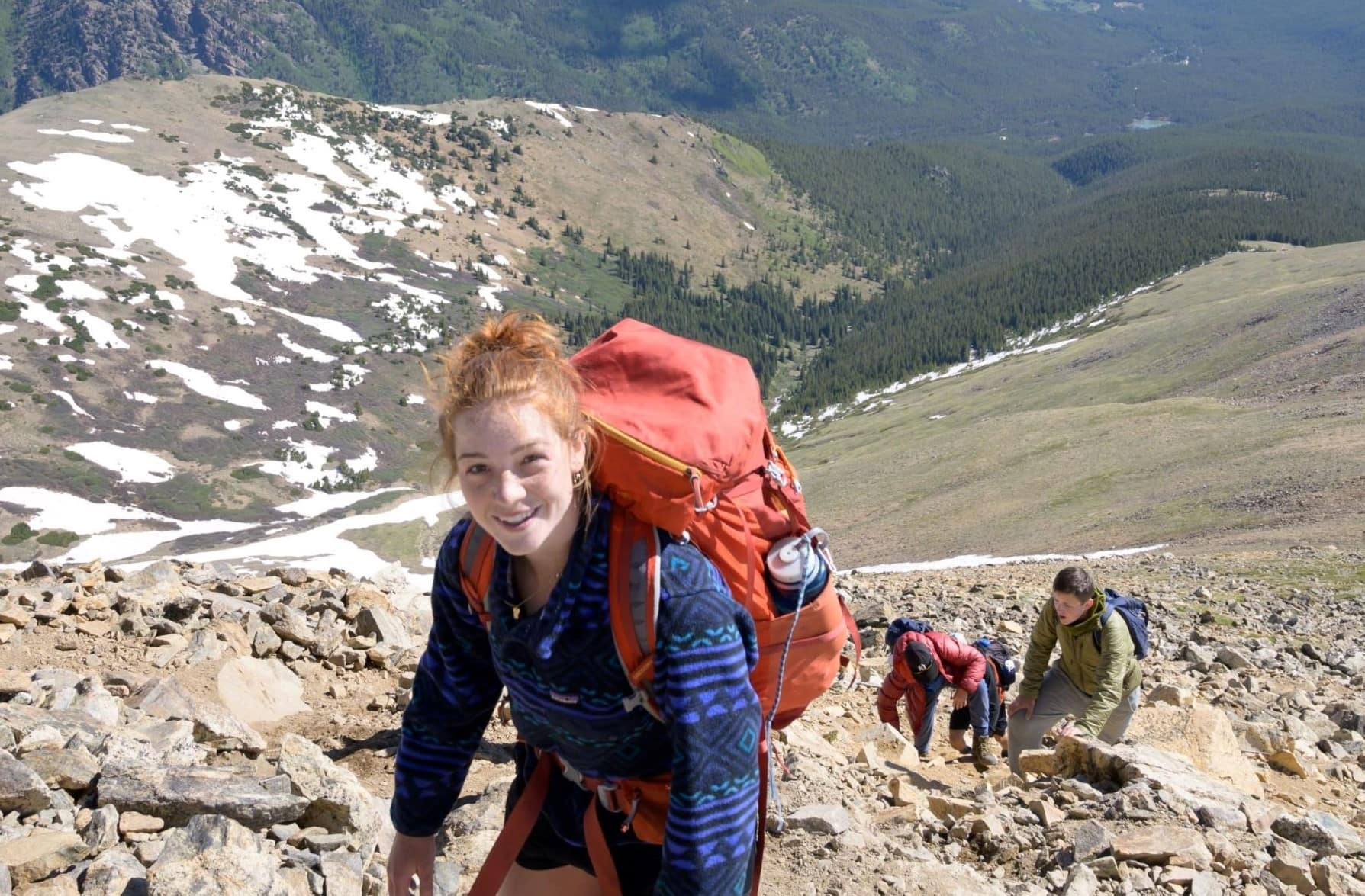 Smiles are the name of the game when your hiking in the Rocky mountains on an Overland teen adventure program