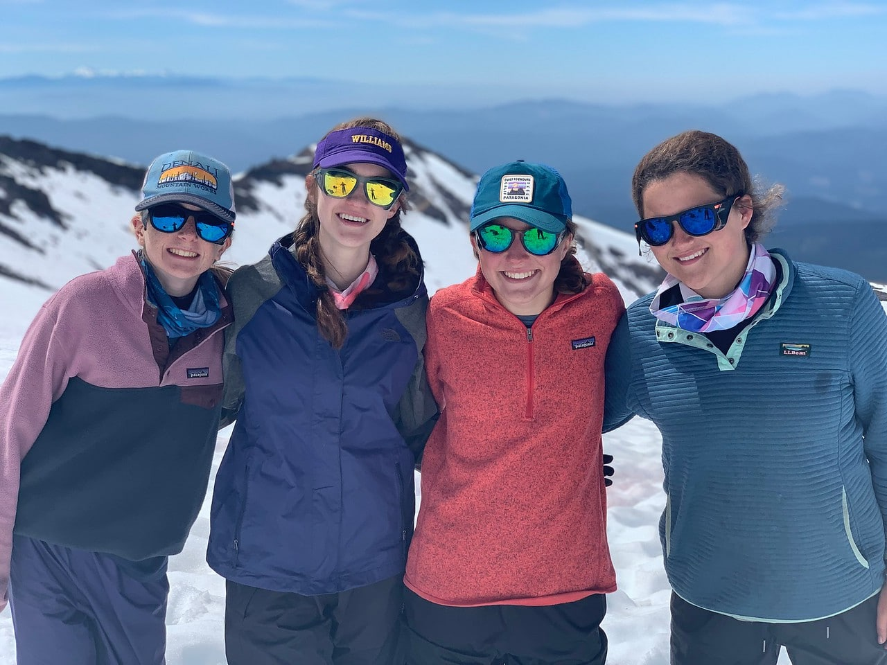 Sunglasses keep you looking cool this summer when campers go hiking in the high sierra on an overland teen adventure camp