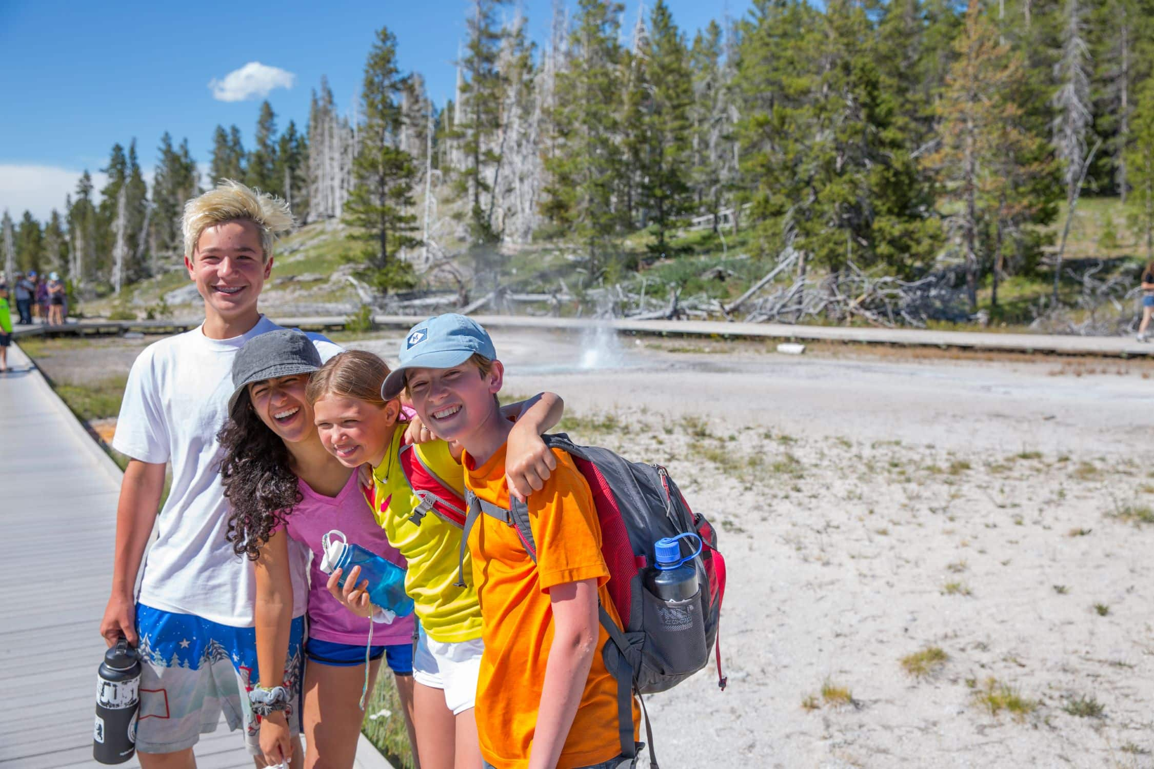 Campers are all smiles when hiking in beautiful Yellowstone this summer