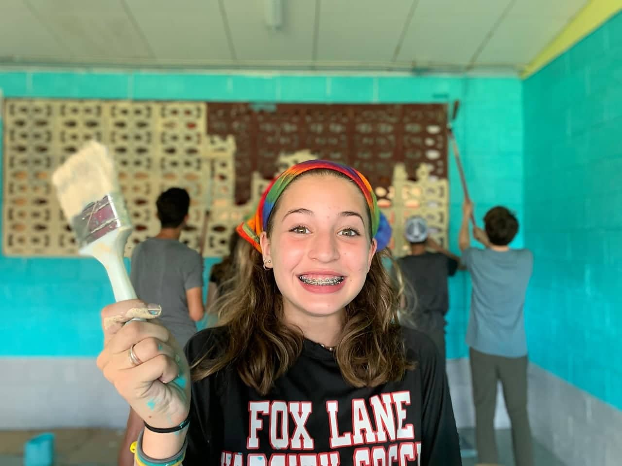 Teen smiling for the camera while working on her language and service trip for teens this Summer in Costa Rica
