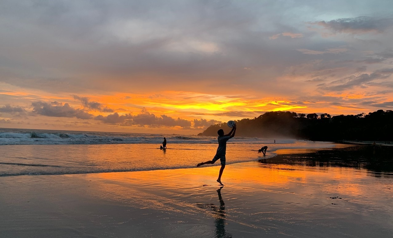 Teens on the beach during a summer sunset while on an adventure and language program in Costa Rica