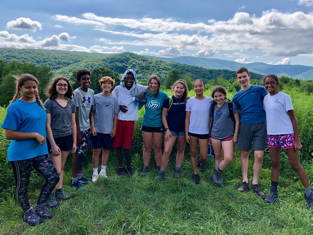 A group of campers takes a day hike in New England this Summer while on a writing program