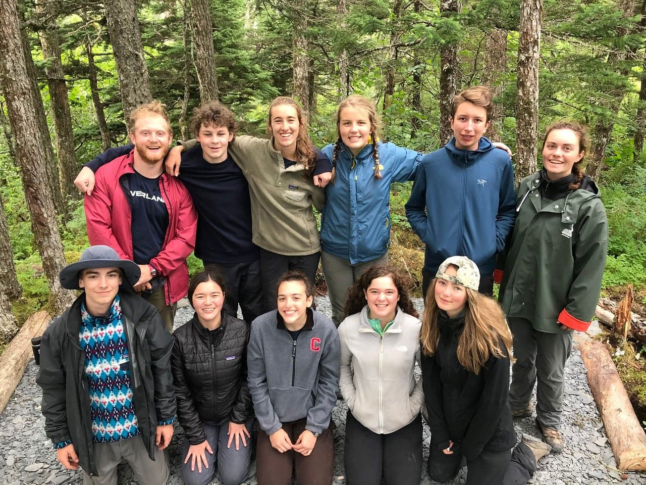 Campers gather for a group photo while on a service and hiking trip in Alaska this Summer