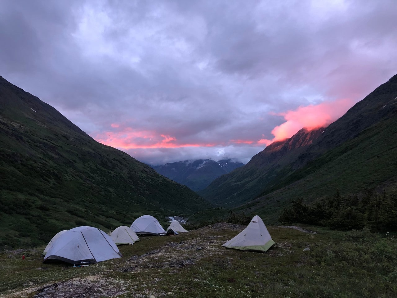 Hikers are tent camping while on a service program in Alaska this Summer