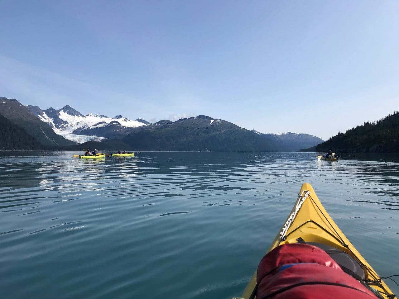 Campers kayaking in Alaska while serving on a Teen Summer program this Summer