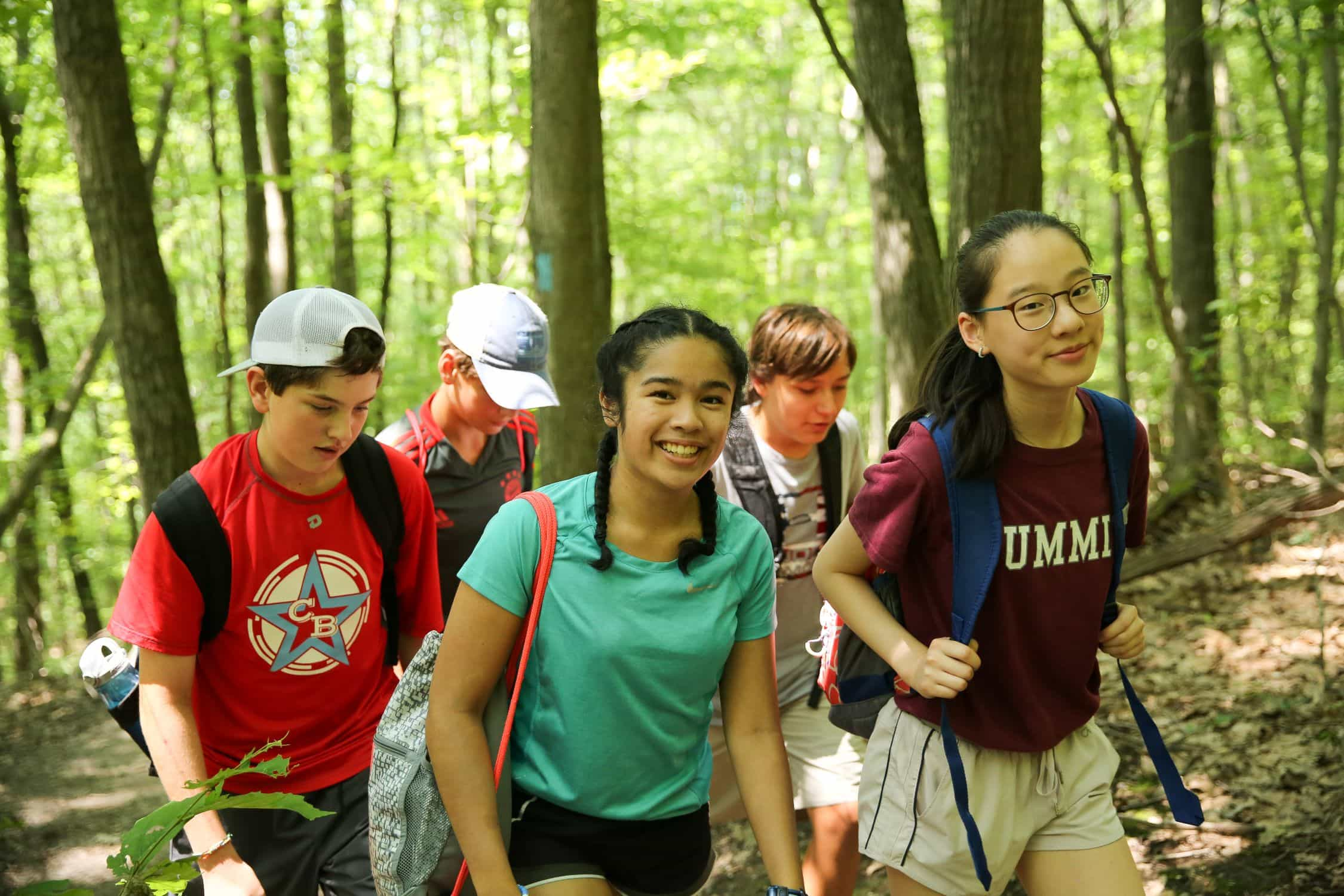 Campers enjoying a summer hike while on a writing program in New England