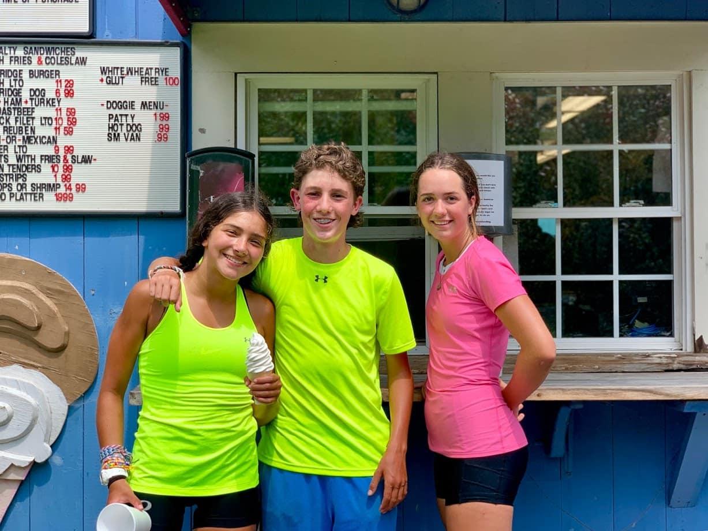 Three friends having a creemee on a teen summer biking trip in Vermont