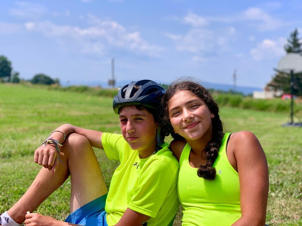 Two friends taking a break in the sun on their teen summer biking trip
