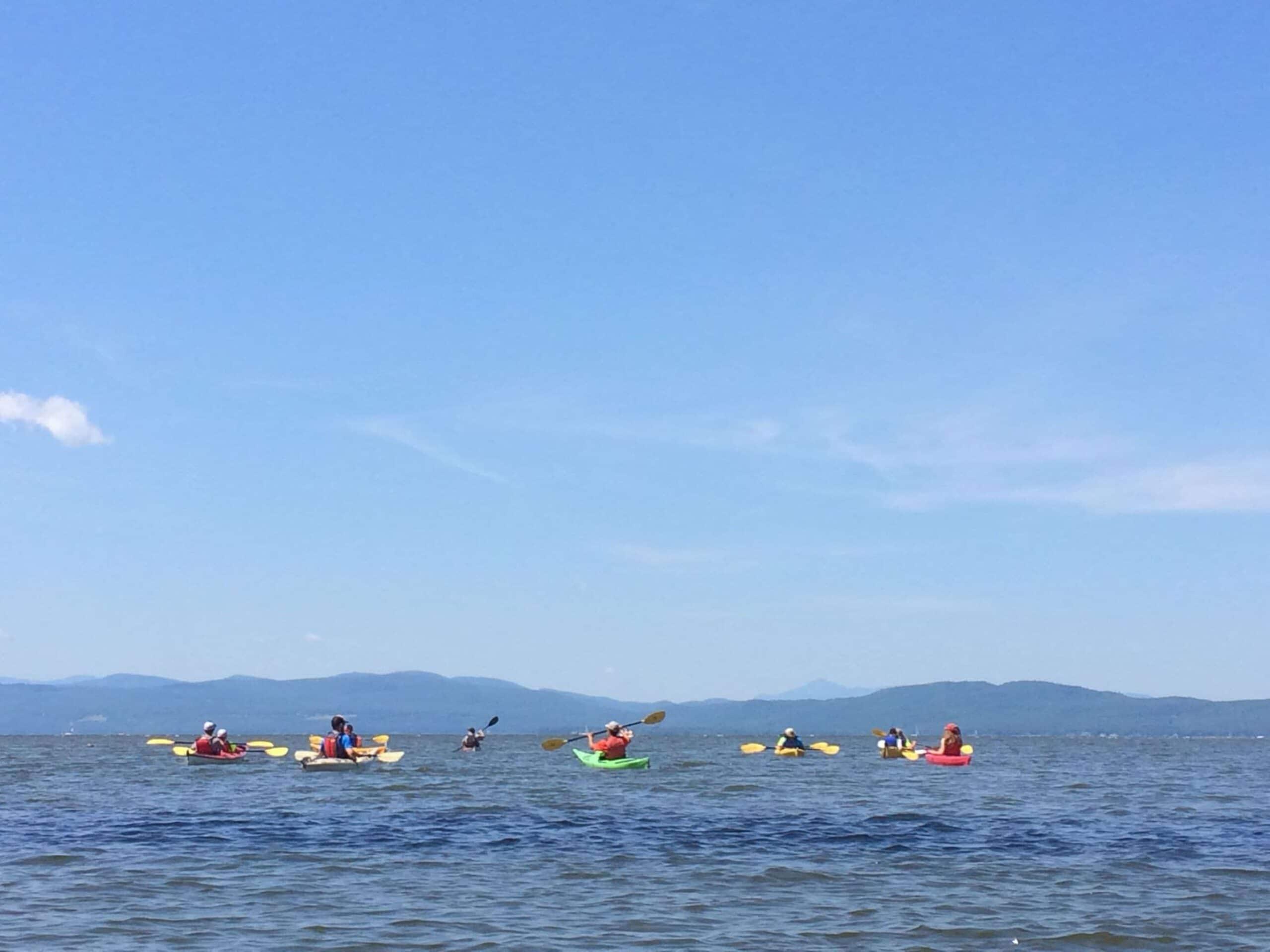 Kayaking on lake Champlain on a teen summer biking trip