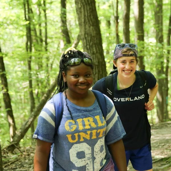 Two teenagers take a hiking while attending a service program in New England this Summer