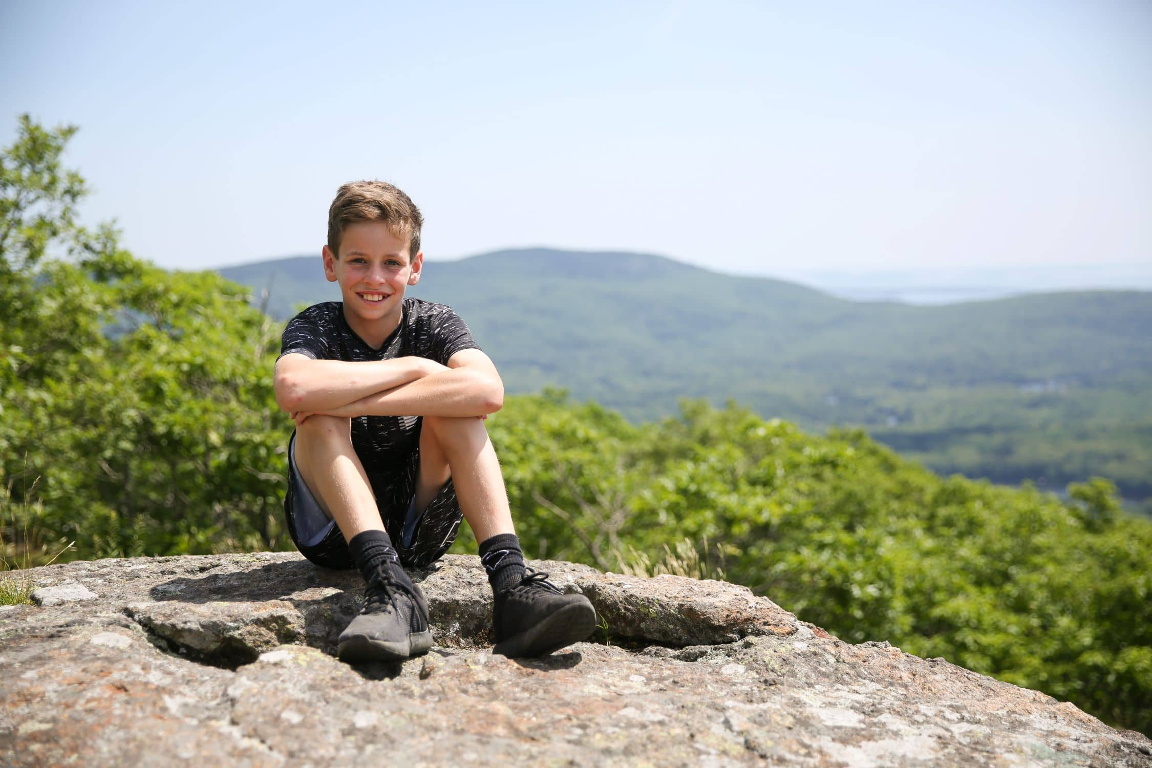 Resting at a lookout point during a teen adventure program