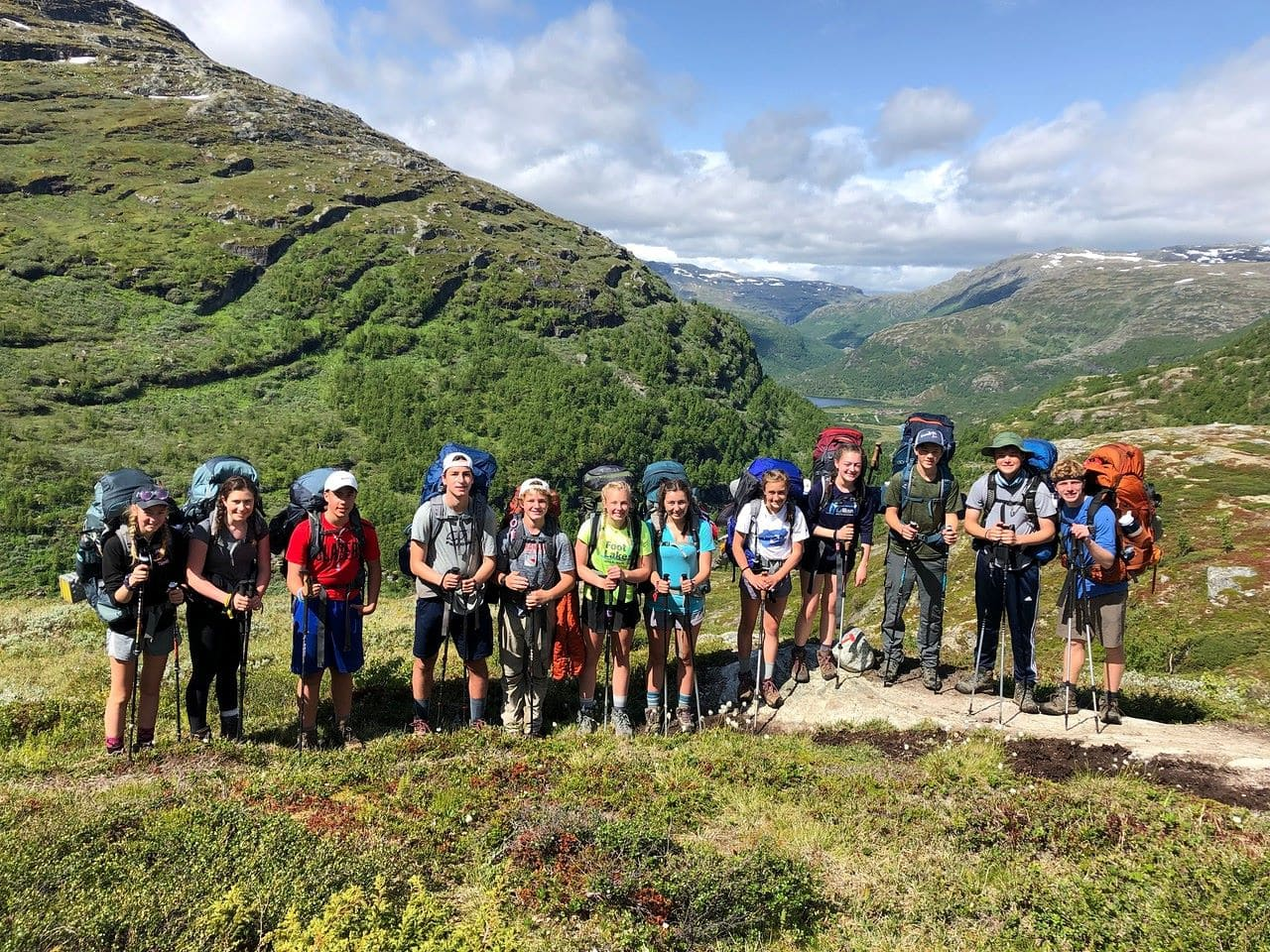 Campers pause for a photo in the Norwegian wilderness this summer on their adventure program