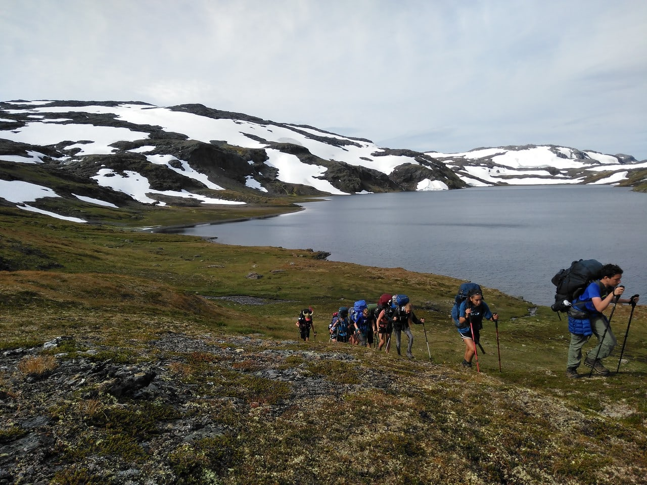 Group hiking hard in Norway this summer on a teen adventure camp