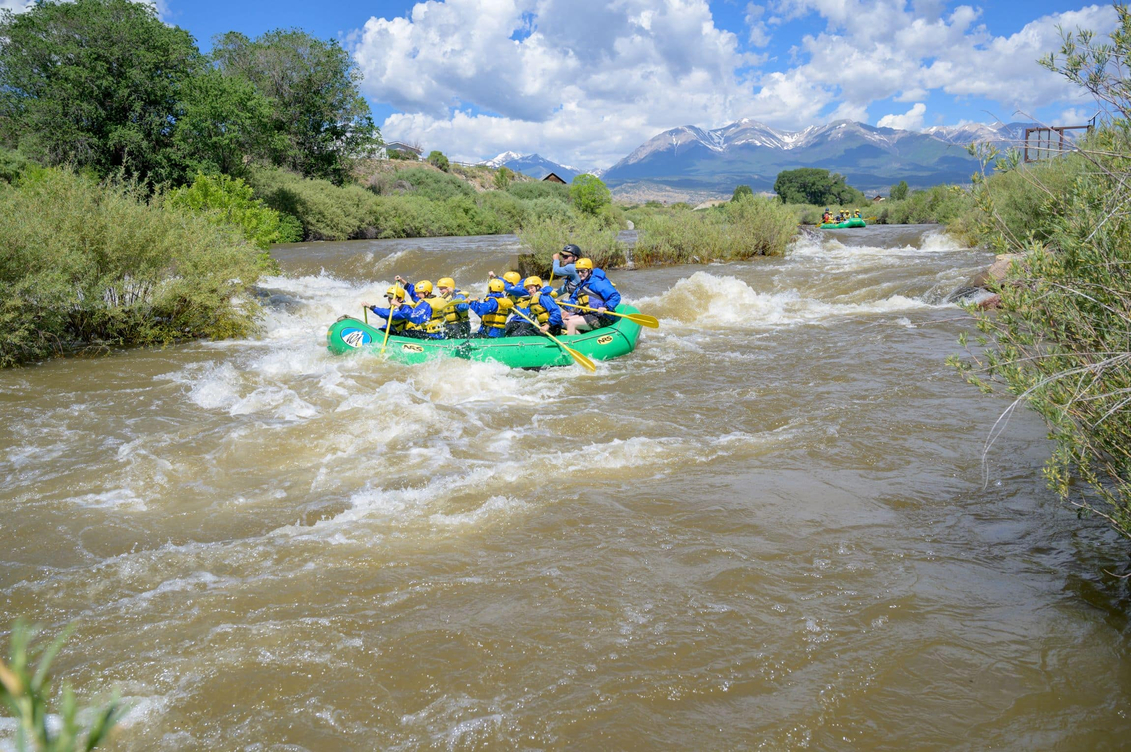 Rafting downstream on a teen adventure program in the rocky mountains