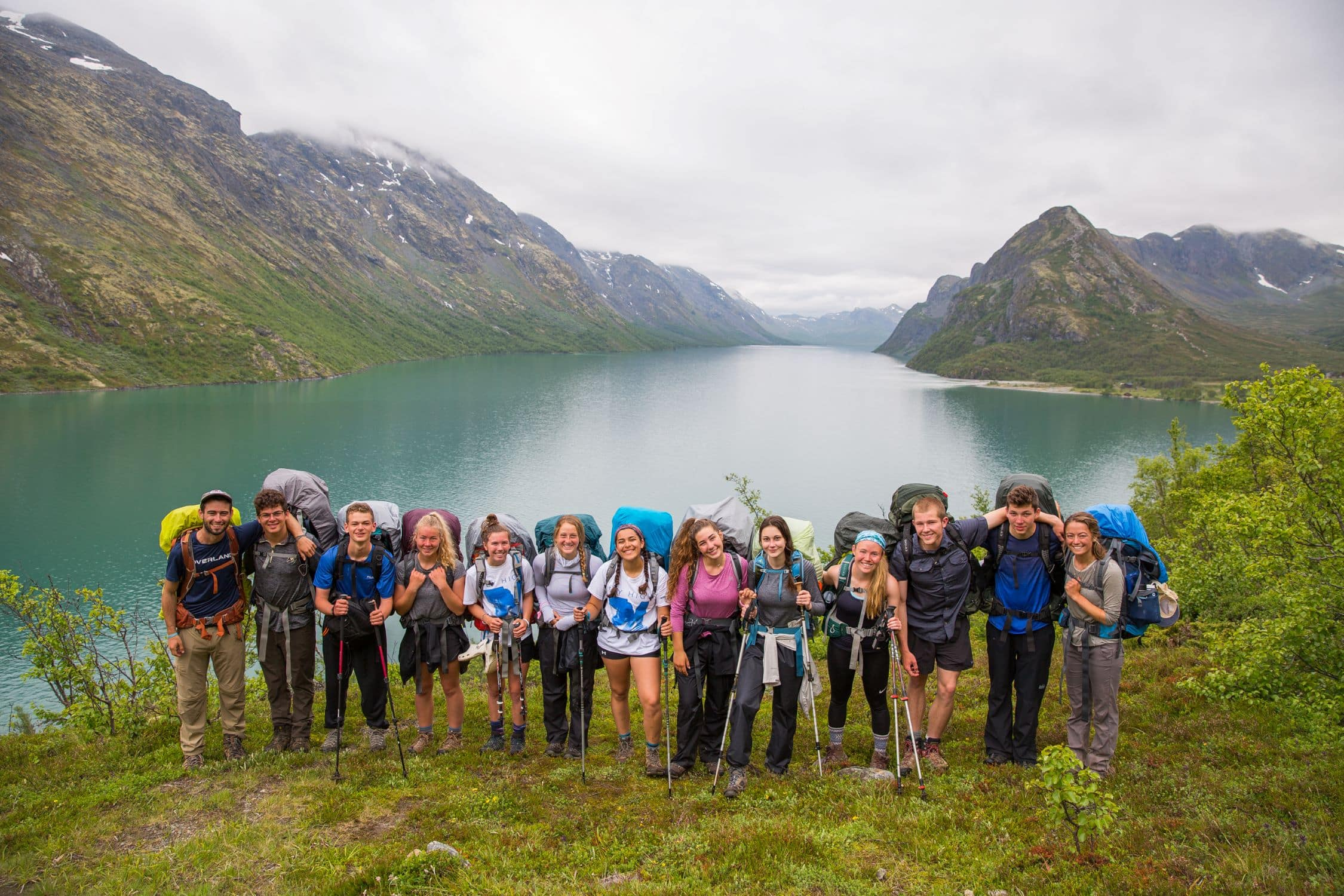 Hikers take a group photo in front of a fjord this summer on a trip to Norway