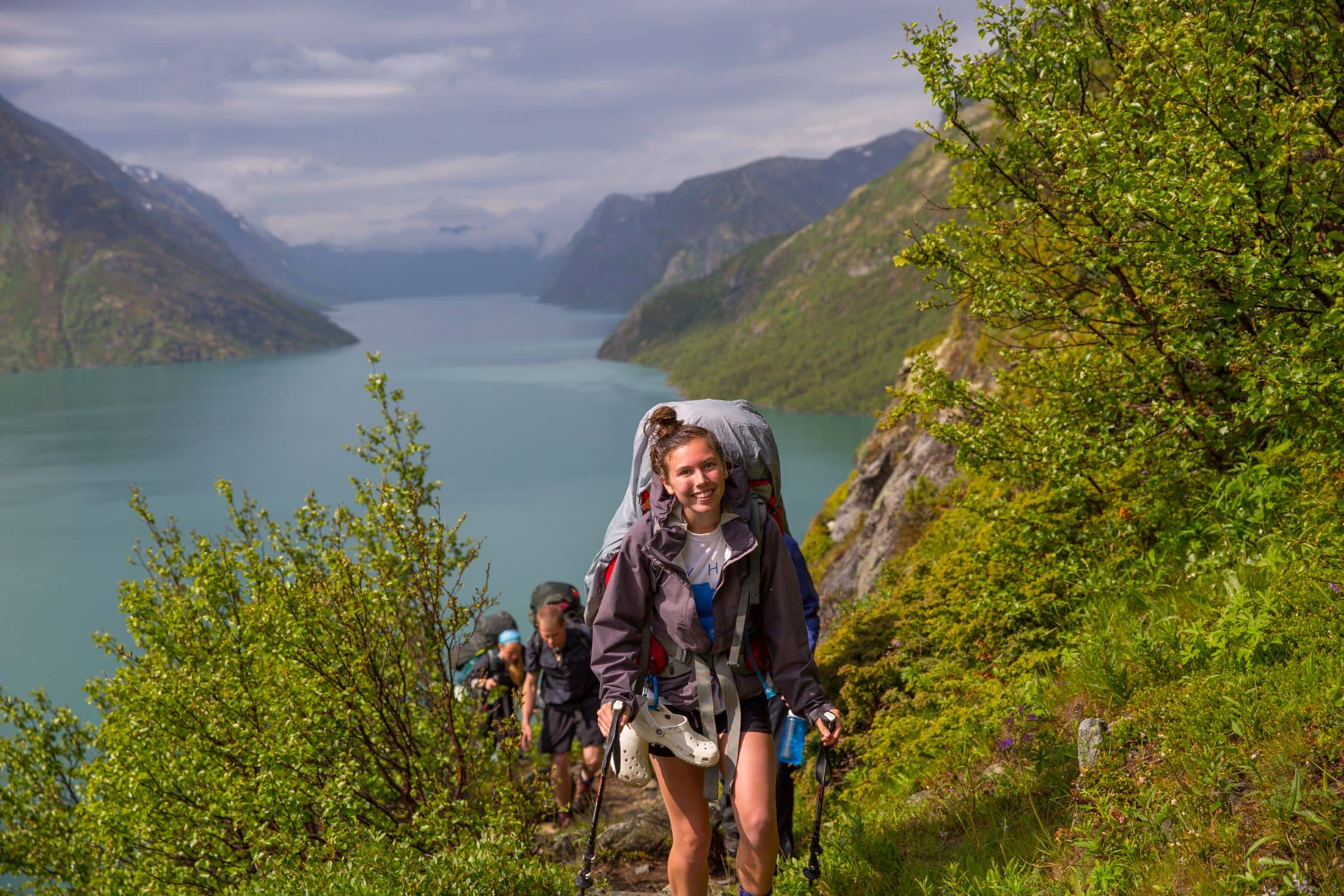 Campers smile in single file while on a hiking trip in Norway this summer