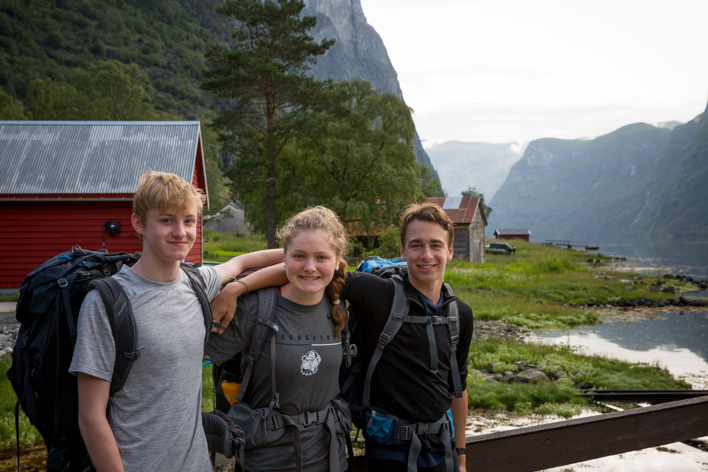 Three campers taking a quick photo before embarking on a hiking trip in Norway this summer