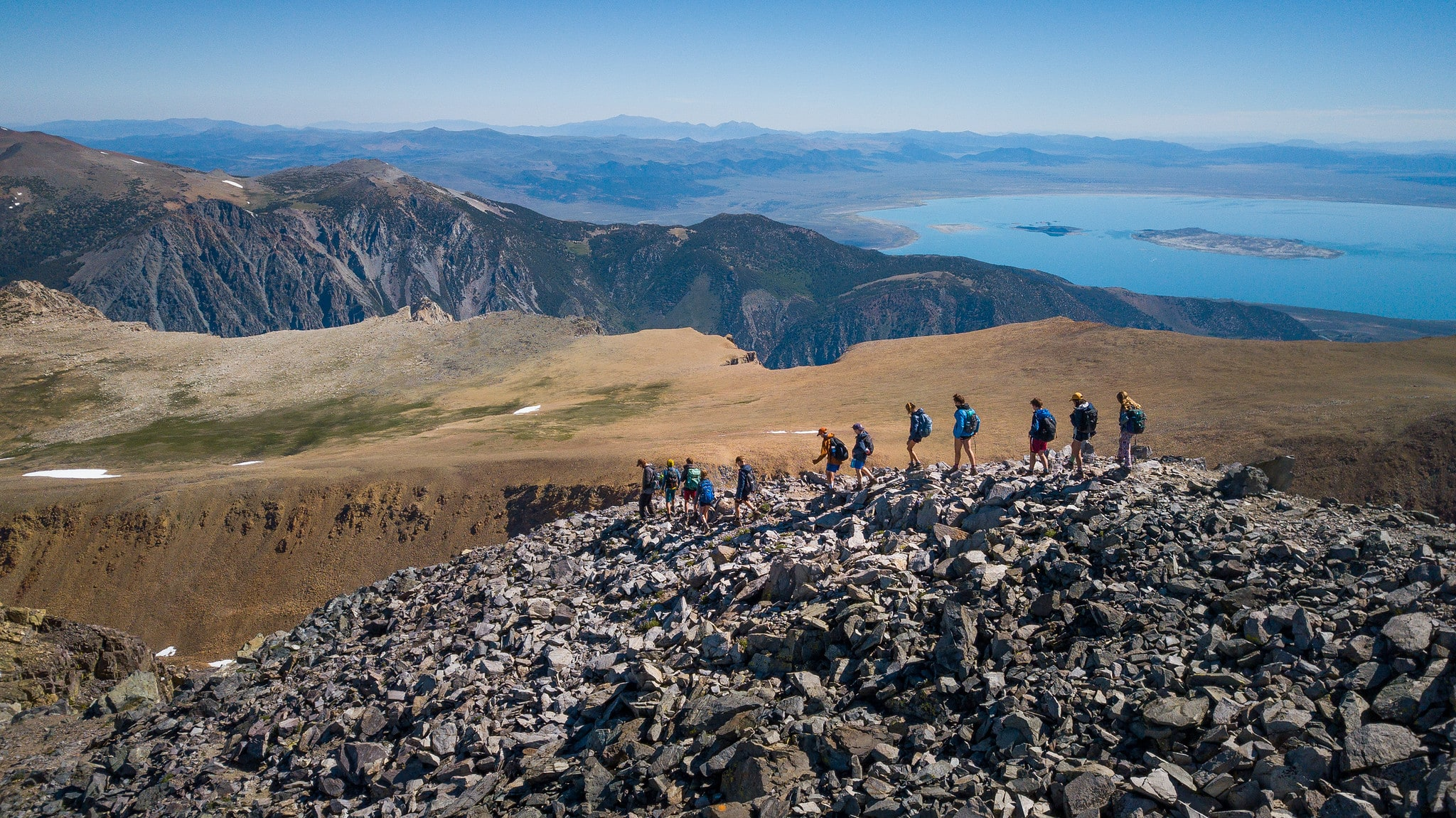 An expansive view from above while teens hike on this summer adventure camp
