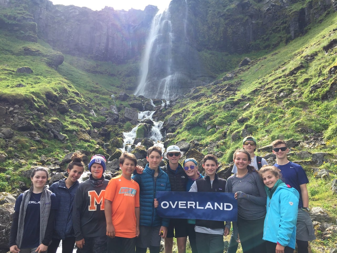 Campers smiling together during their adventure this summer on an Overland teen adventure program