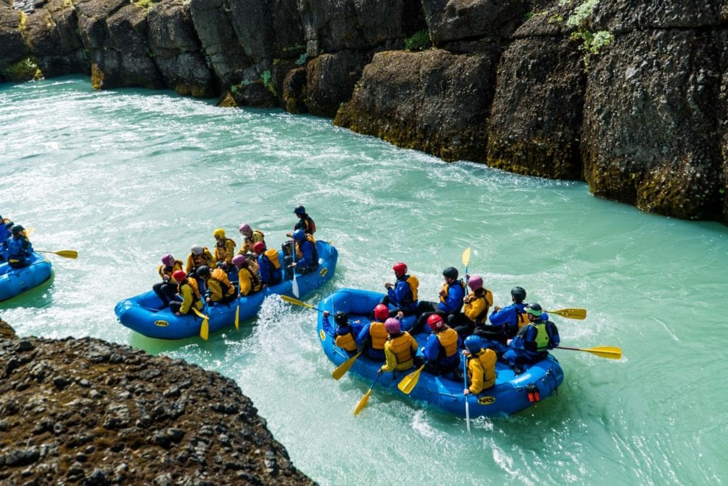 Rafting down a glacial river is cool on an Overland teen adventure program