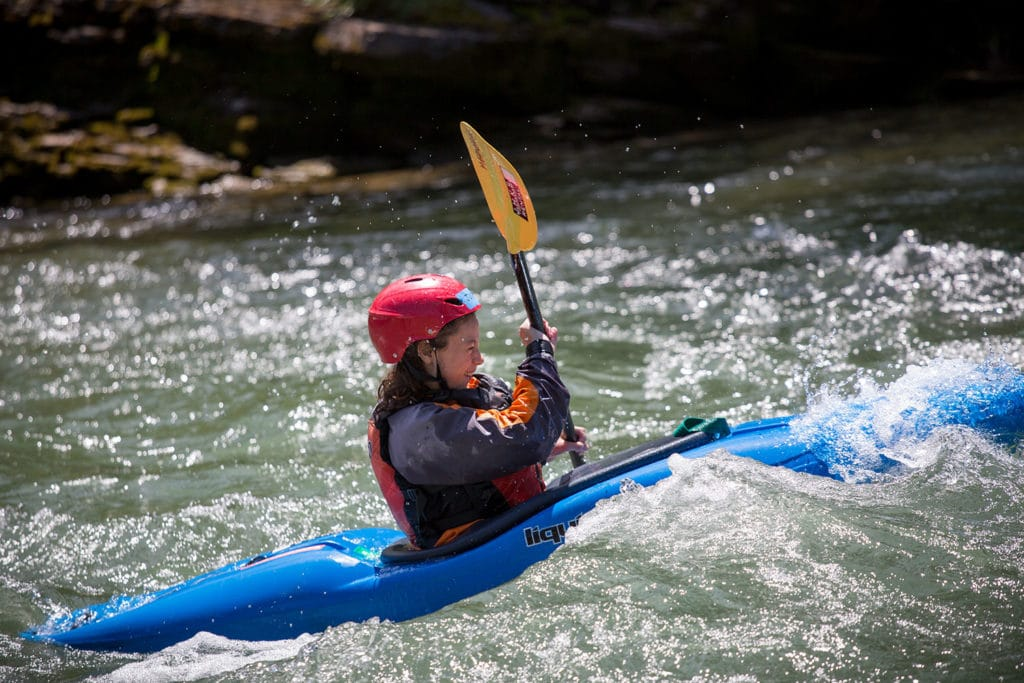 Julia whitewater kayaking in Yellowstone and the Tetons