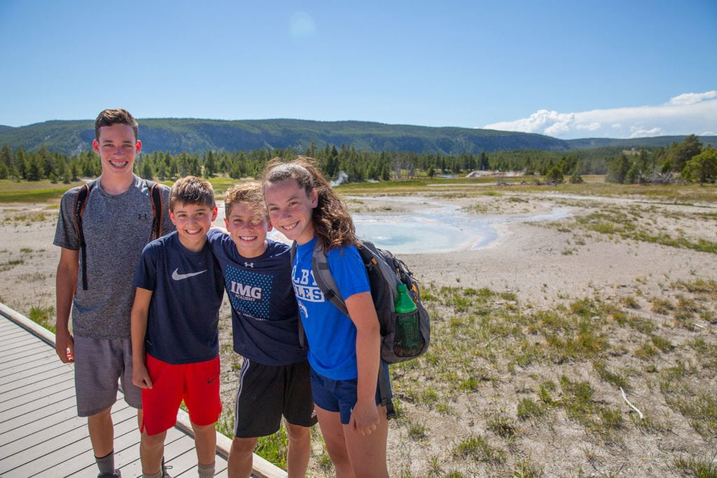 Julia and friends pose in Yellowstone during their teen adventure travel trip
