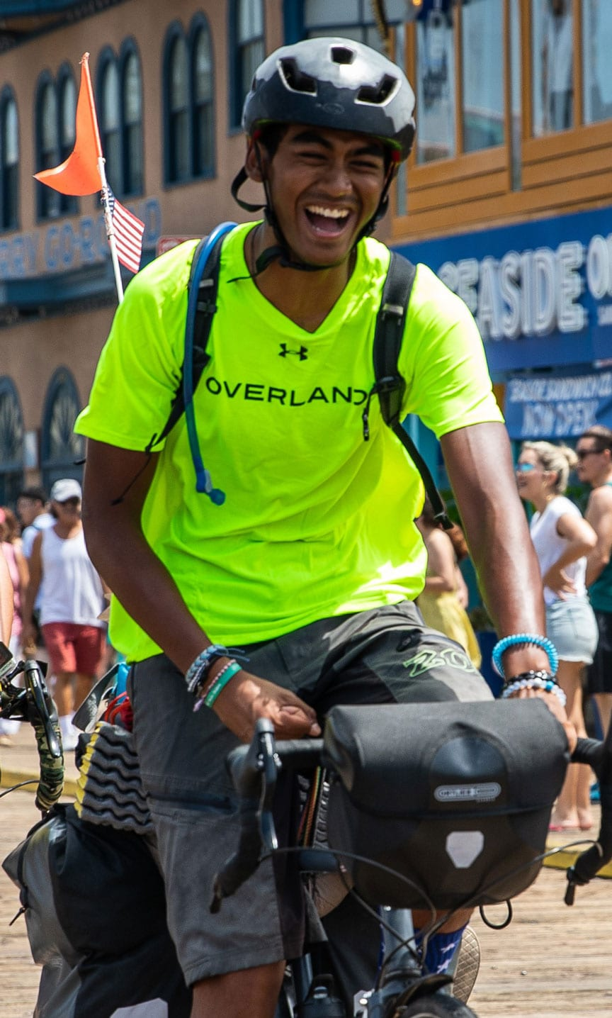 Teen camper smiles as he sets off on a summer adventure - biking coast to coast on an Overland trip!
