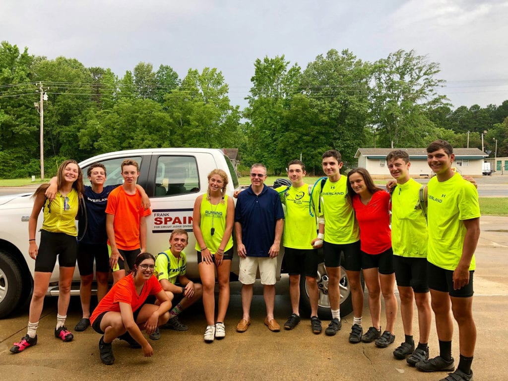 An American Challenge group poses in their high-visibility clothing while stopping in town on our teen biking trips