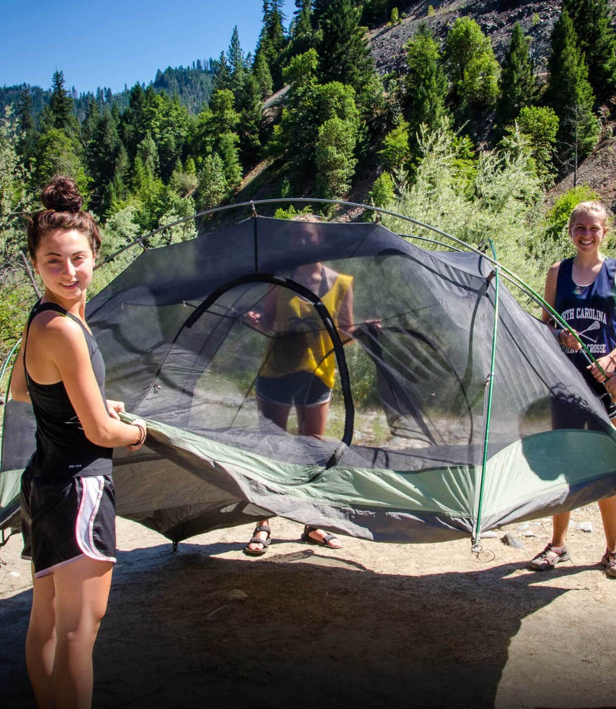 Campers pitch a tent for the night while hiking on a teen adventure program this summer